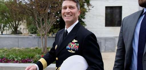 Navy Rear Adm. Ronny Jackson walks on Capitol