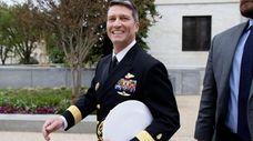 Navy Rear Adm. Ronny Jackson walks on Capitol