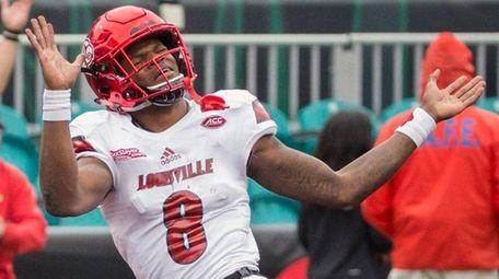 Louisville quarterback Lamar Jackson celebrates a touchdown during