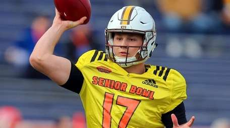 Josh Allen of Wyoming throws a pass during