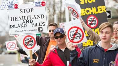 More than 100 demonstrators converged outside Islip Town