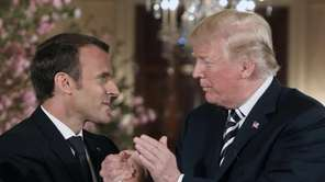 Macron and Trump shake hands during a joint