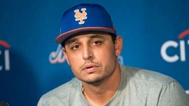 Mets pitcher Jason Vargas talks to reporters on