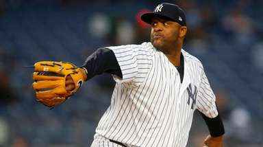 CC Sabathia of the Yankees pitches in the