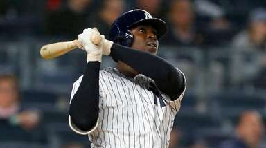 Didi Gregorius of the Yankees follows through on