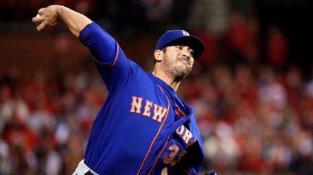 Mets relief pitcher Matt Harvey throws during the