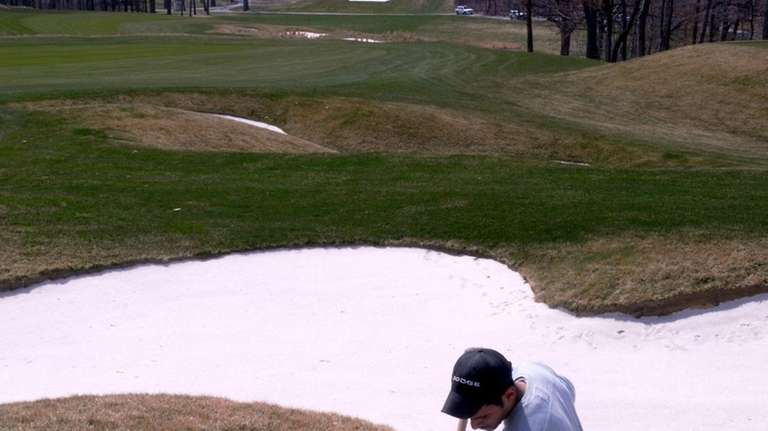 Hamilton Copes tends to a bunker on the