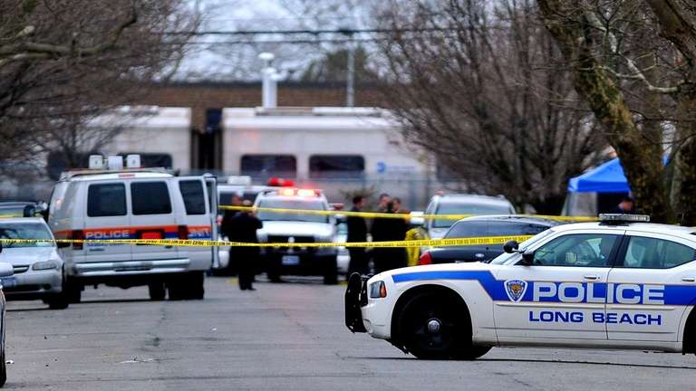 Officials investigate the scene where a man was