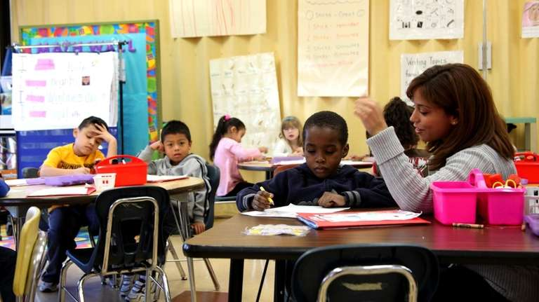 A kindergarten teacher instructs young students at Moriches