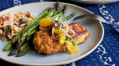 Seasoned chicken breasts are seared and topped with