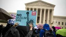 Demonstrators protest outside the Supreme Court in Washington