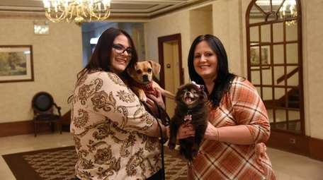 Nicole, left, and Alicia Laurentz, with their dogs,