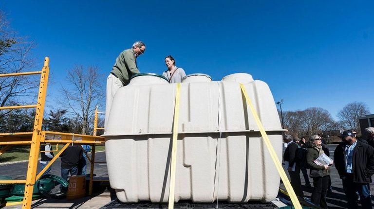 Fuji Clean USA's Scott Samuelson, left, explains to