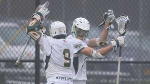 Ward Melville's Zach Hobbes celebrates with Malachy McAvoy