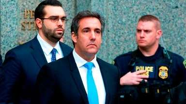 Michael Cohen, President Donald Trump's personal attorney, center,