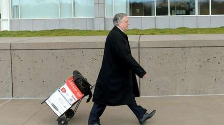 Edward Mangano arrives at the federal courthouse in
