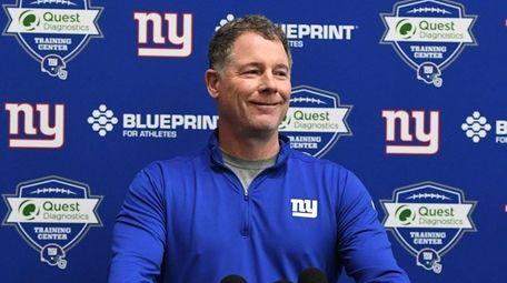 Giants coach Pat Shurmur speaks to the media
