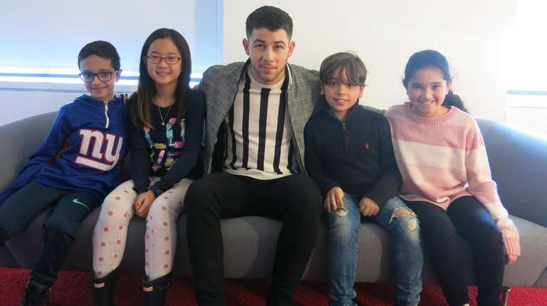 Singer and actor Nick Jonas with Kidsday reporters