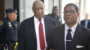 Comedian Bill Cosby comes out of the Montgomery
