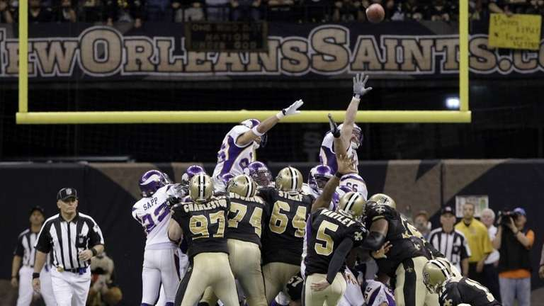 New Orleans Saints kicker Garrett Hartley (5) kicks