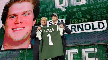 USC's Sam Darnold poses for photos with commissioner