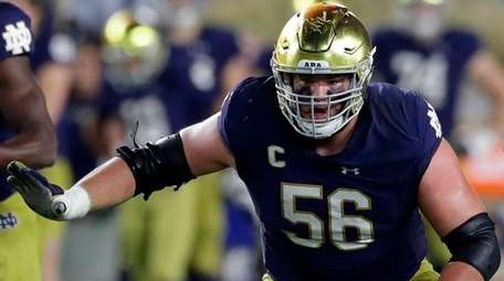 Notre Dame offensive lineman Quenton Nelson defends the