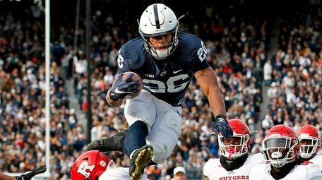 Penn State's Saquon Barkley hurdles Rutgers' Kiy Hester