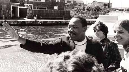 The Rev. Martin Luther King Jr. greets people