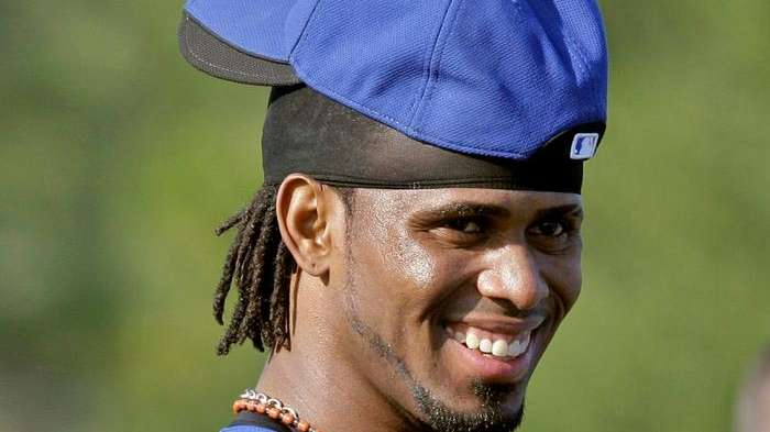 Jose Reyes smiles during a workout on his