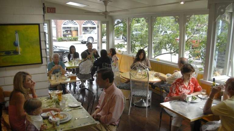 The enclosed patio at The Bellport restaurant, located