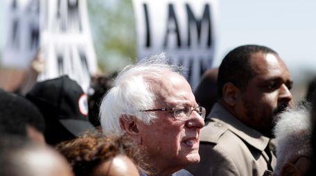 Sen. Bernie Sanders, I-Vt., takes part in a