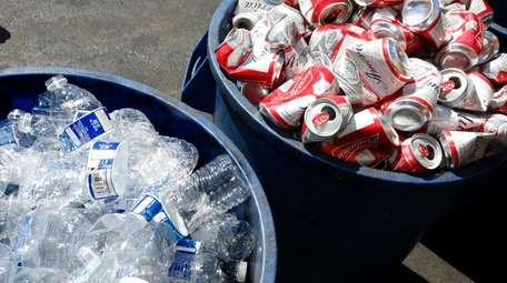 Cans and plastic bottles brought in for recycling