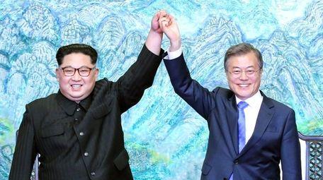 North Korean leader Kim Jong Un, left, and