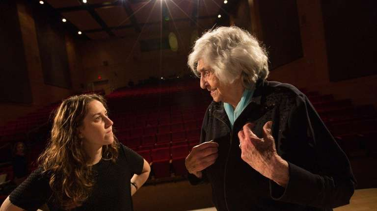 Director Barbara Kaynan, left, chats with Holocaust survivor