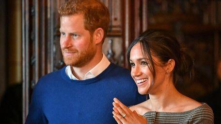 Prince Harry and Meghan Markle watch a