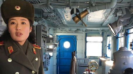 A North Korean military guide leads a tour