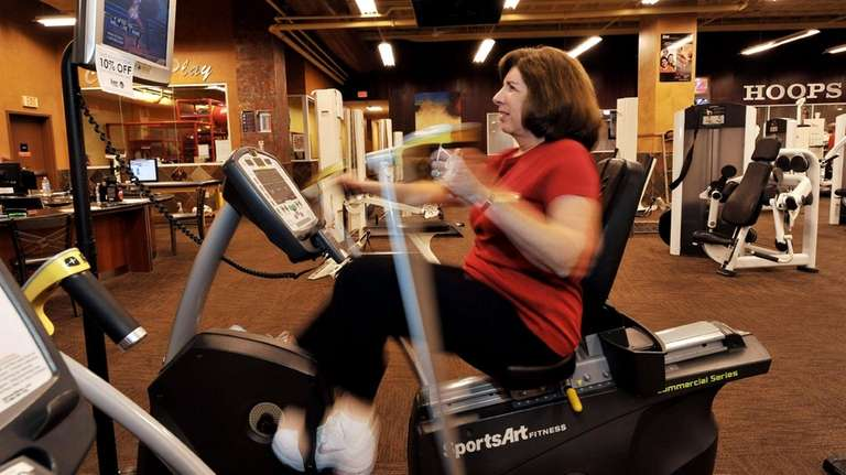 Janet Katzin, 61, of Jericho, exercises on a