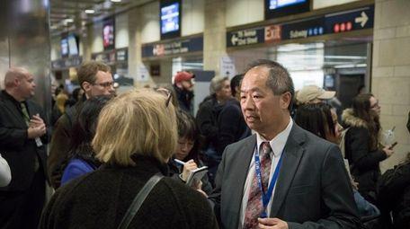 LIRR president Phillip Eng, right, meets a commuter
