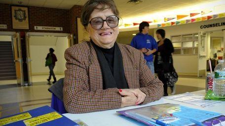 Lil Livolsi, 83, at her job as a