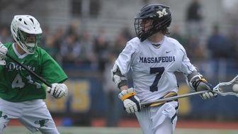 Garrett Gibbons of Massapequa, right, gets in position