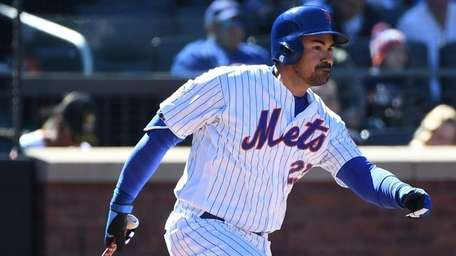 Mets first baseman Adrian Gonzalez singles against the