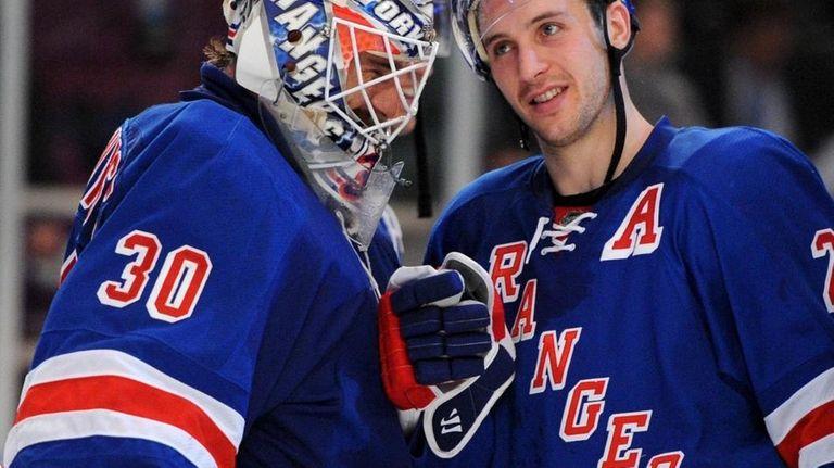 The Rangers' Ryan Callahan congratulates Henrik Lundqvist after