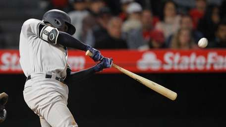 The Yankees' Didi Gregorius hits a home run