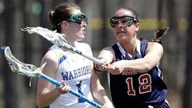 Miller Place's Gionna Altebrando (12) defends against Comsewogue's
