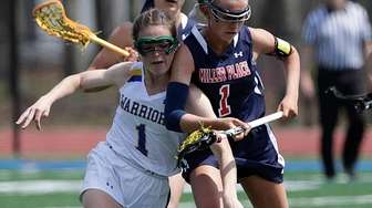Comsewogue's Hannah Dorney (1) controls the loose ball