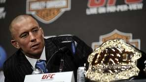 Georges St-Pierre speaks at a press conference for