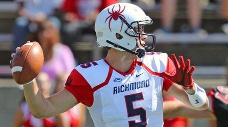 Richmond quarterback Kyle Lauletta drops back to pass