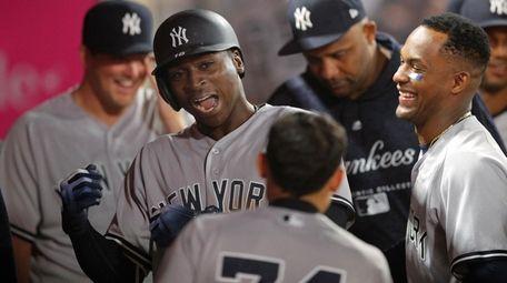 The Yankees' Didi Gregorius, second from left, celebrates