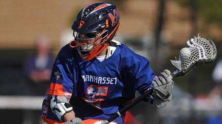 Peter Lapinaof Manhasset stickhandles behind the net during