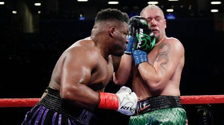 Jarrell Miller, left, punches Johann Duhaupas during the